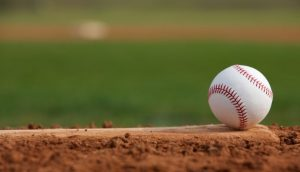 stock-photo-baseball-on-the-pitchers-mound-145679393